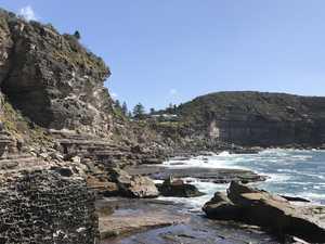 Paraglider smashes onto rocks at Avalon