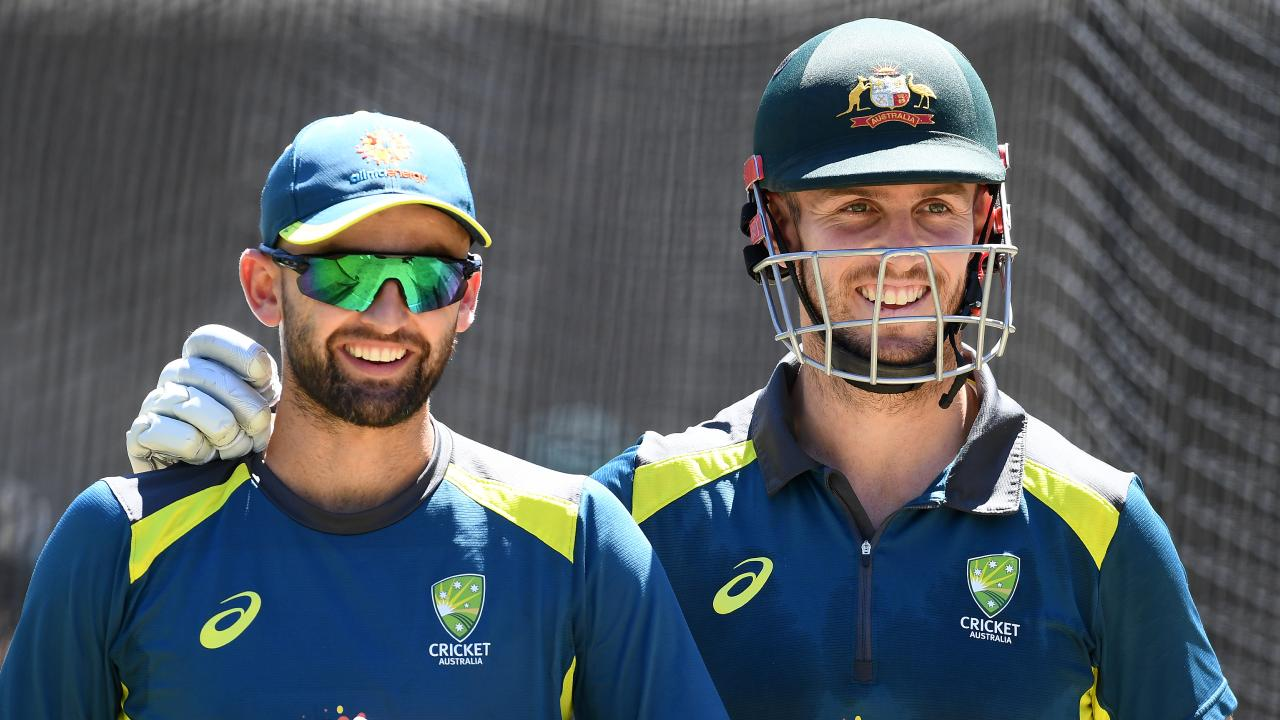 Nathan Lyon and Mitch Marsh during the Christmas Eve training session. Picture: Getty