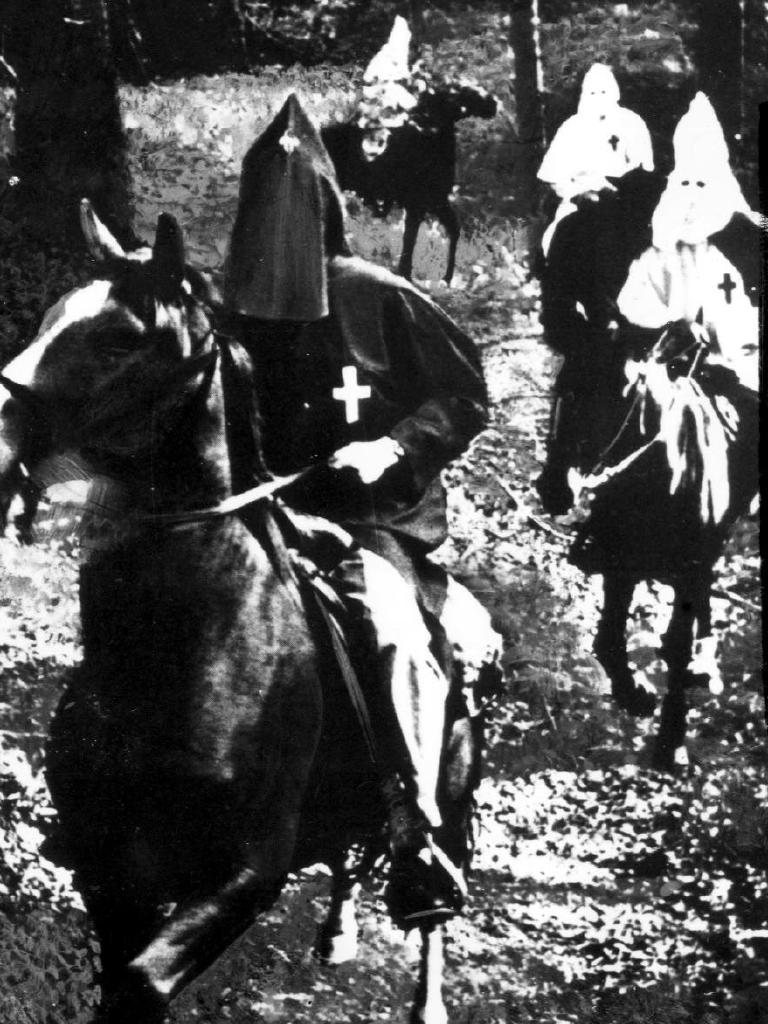 Klansmen on horseback in the Deep South of the USA. Source: Historical United States of America.
