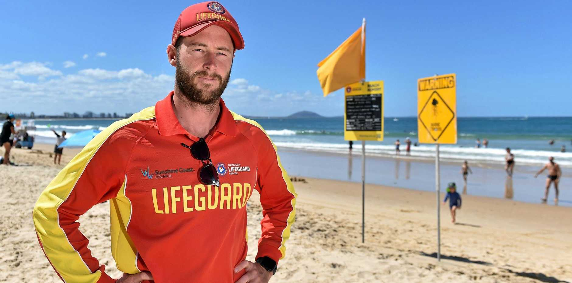 STAY SAFE: Lifeguard Nick Bolton, on duty at Mooloolaba Beach, has seen his fair share of incidents involving children.