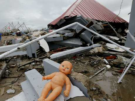 A doll lays outside a damaged house following the tsunami in Sumur, Indonesia. Picture: Tatan Syuflana/AP