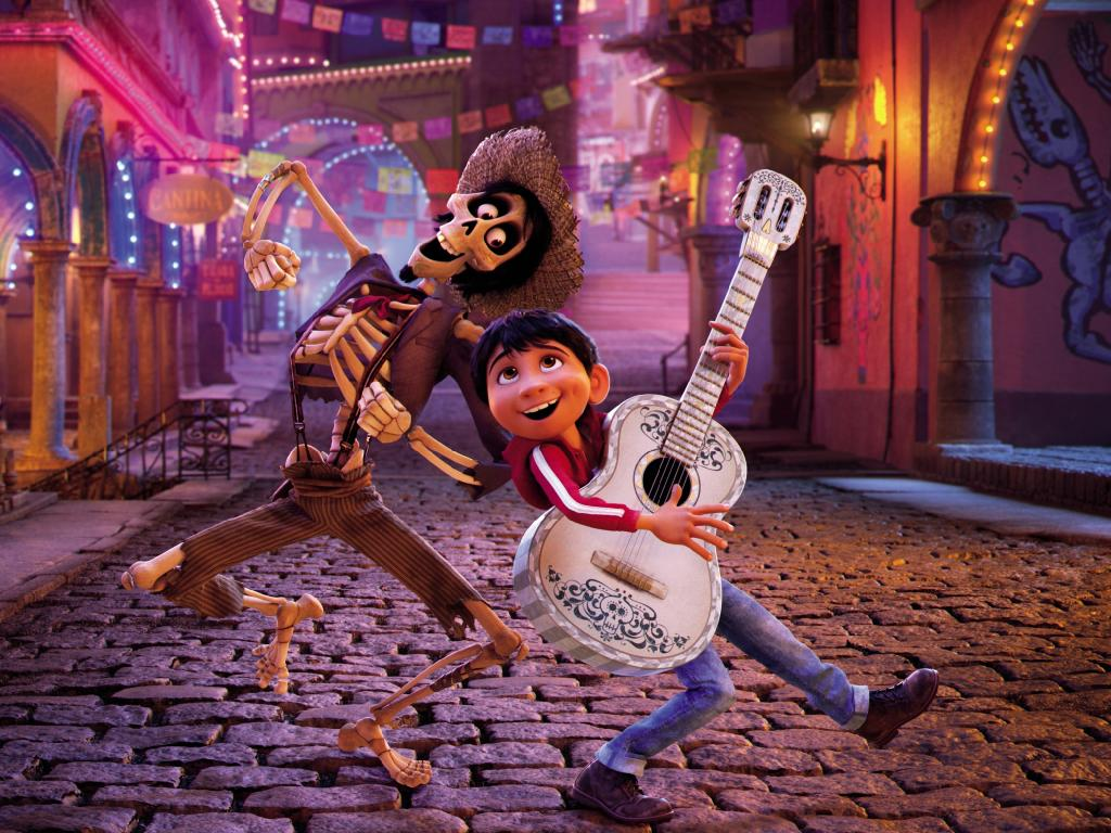 In a scene from Disney Pixar's animated film Coco, Miguel's (voiced by Anthony Gonzalez) love of music leads him to the Land of the Dead where he teams up with charming trickster Hector (Gael Garcia Bernal). © 2017 Disney Pixar. All Rights Reserved.