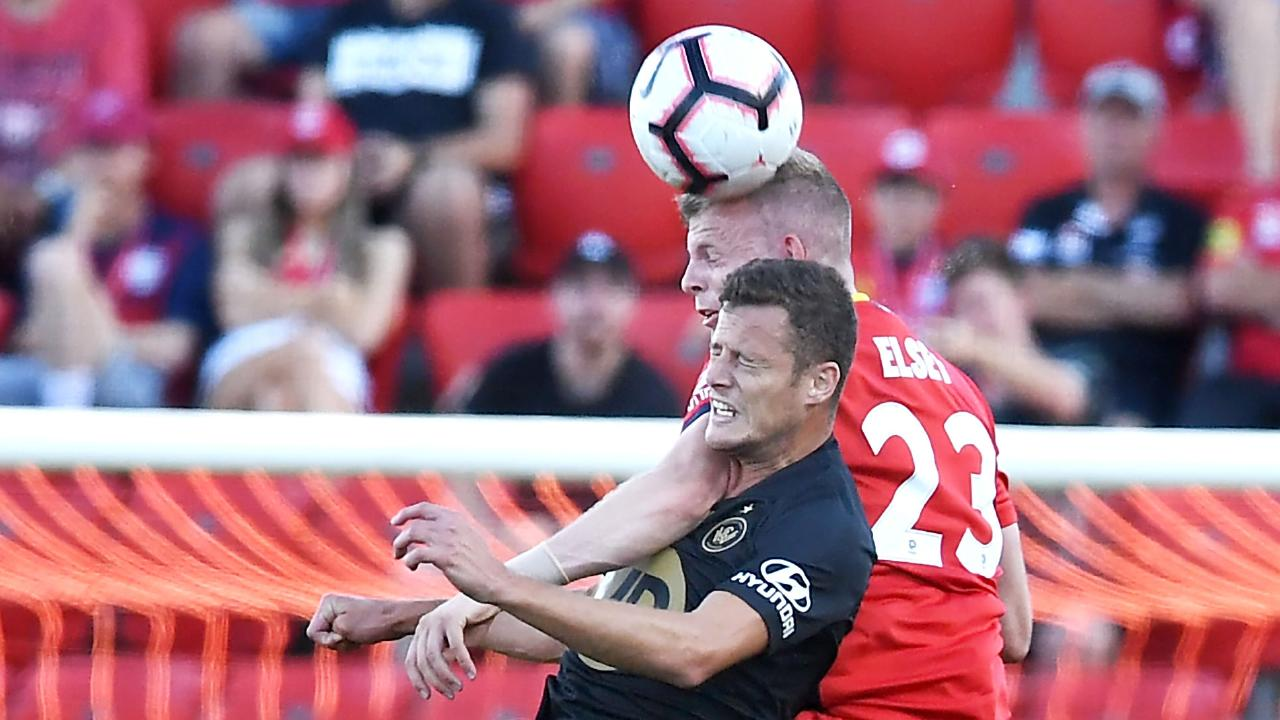 Oriol Riera of the Wanderers heads against Jordan Elsey of Adelaide. Picture: Getty Images