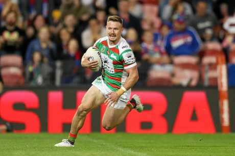 Souths Damien Cook scores a try during the Newcastle Knights v South Sydney NRL match at McDonald Jones Stadium, Newcastle. Picture: Brett Costello