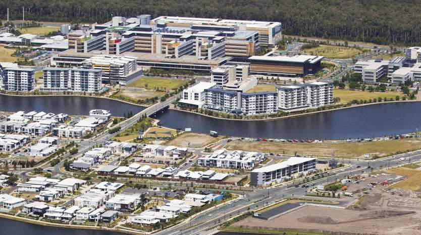 Aerial view over Birtinya with the Sunshine Coast University Hospital at top. Photo Lachie Millard
