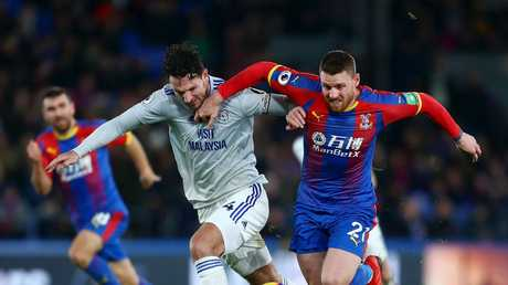 Connor Wickham of Crystal Palace challenges for the ball with Sean Morrison of Cardiff City