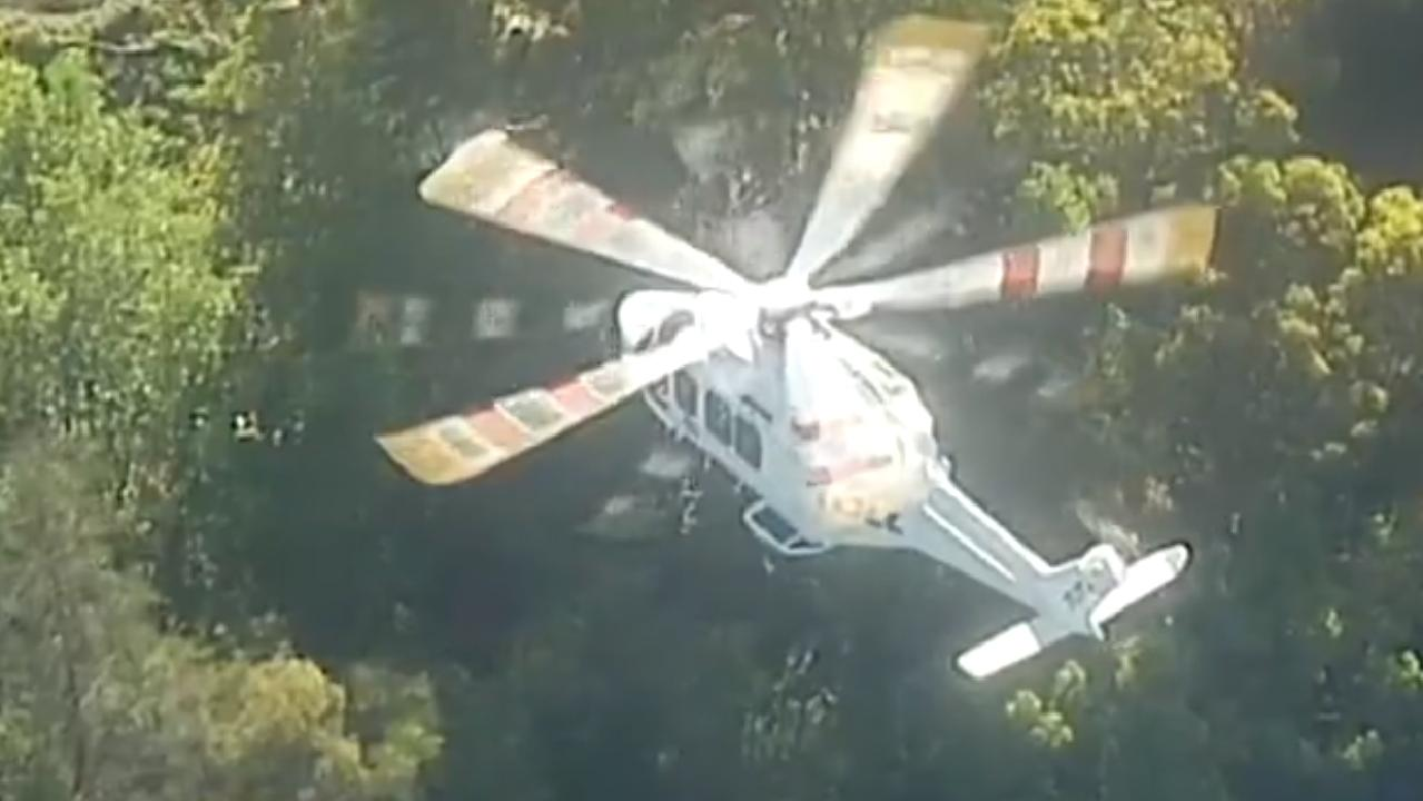 A man is being rescued after falling down a cliff. Picture: 7 News