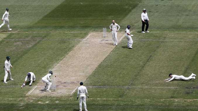 India's Ajinkya Rahane  makes his ground as Tim Paine accidentally dislodges a bail at the MCG on Thursday. Picture:  Michael Dodge/Getty Images
