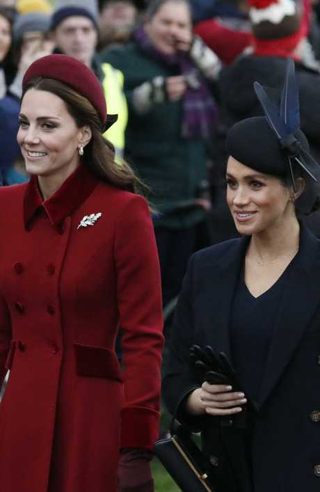 Kate and Meghan were photographed together outside St Mary Magdalene Church in Norfolk on Christmas Day. Picture: AP PhotoFrank Augstein