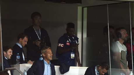 Keisuke Honda of the Victory (fourth left) is seen in the grandstand during the Melbourne derby
