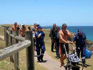 Pram with baby inside rolls down edge of headland
