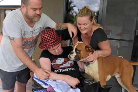 DOING IT TOUGH: Daniel, Ethan and Ellie Fuller with Roxy, one of their dogs, are happy to all be together for Christmas after being forced to move in with Daniel's parents in the past year due to the cost of Ethan's medical treatments.
