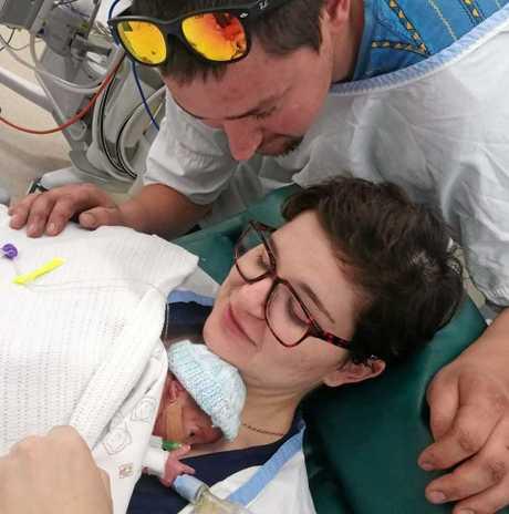 Joe Ashton (top) and Morgan Deasy holding son Henry Joseph Ashton.