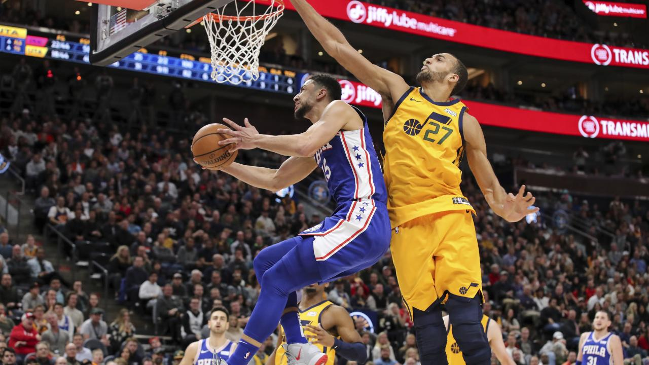 Ben Simmons beats Jazz centre Rudy Gobert to the rack in the Sixers big win. Picture: AP