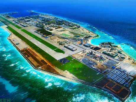 China's heavily fortified Fiery Cross reef, in a propaganda image released by the People's Liberation Army. Every inch is dedicated to operating combat aircraft, warships, missile batteries and sensors.