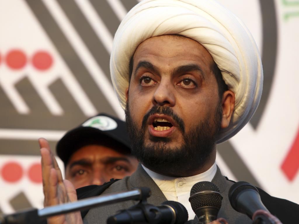 Qais Khazali, the head of the Iran-backed Asaib Ahl al-Haq, seized on Donald Trump's surprise visit to Iraq and demand US forces leave the country. Picture: AP Photo
