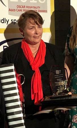 Loretto Reiken with her OSCAR hospitality award.