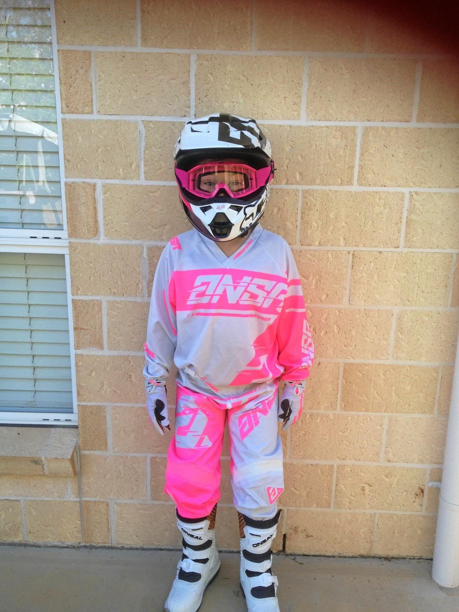 The girls Christmas Day ready to try out their new motorbikes all kitted up in their new safety gear.