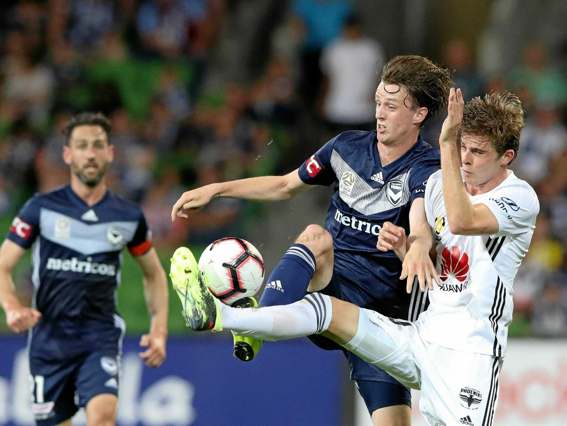 Melbourne Victory's Josh Hope and Wellington's Alex Rufer contest possession on Friday night at AAMI. Picture: David Crosling/AAP