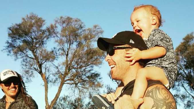 Chris Taylor with his son. Picture: Facebook