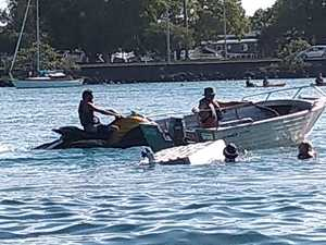 PHOTOS: Couple rescued from sinking boat