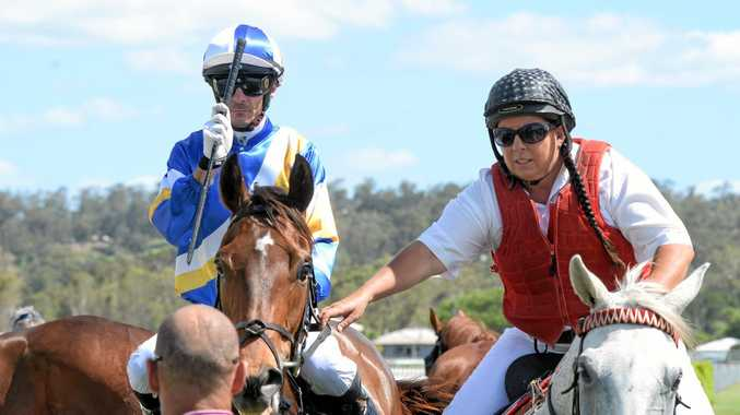 Jockey Justin Stanley guides Watchmen back to the Ipswich Turf Club enclosure after his win at Ipswich racetrack.
