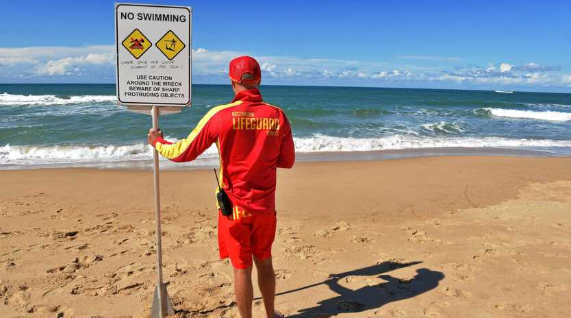 HORROR SEASON: More people have drowned on Coast beaches this season than any other in recorded history. Pictured is Senior Lifeguard Matt Hadland at Dicky Beach, where a man drowned Saturday afternoon.