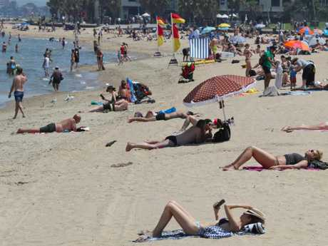 St Kila beach has been packed with people since the heatwave hit. Picture: David Crosling