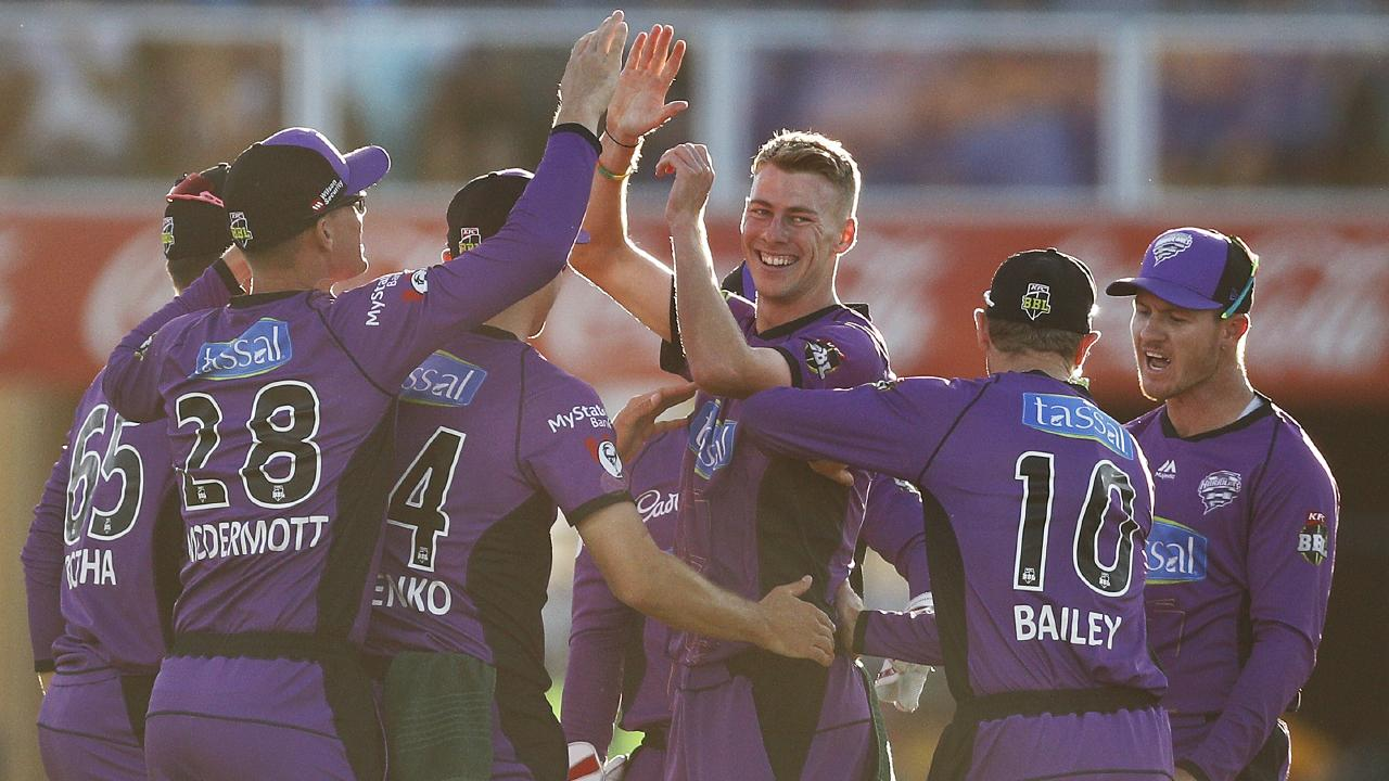 Riley Meredith, of the Hurricanes, centre, celebrates after dismissing Cameron Bancroft of the Scorchers during the Big Bash League match. Picture: Daniel Pockett/Getty Images