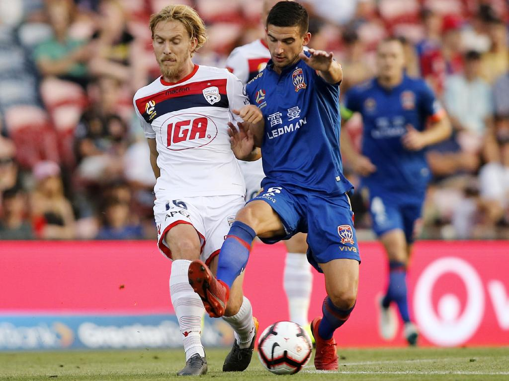 Adelaide United's Ben Halloran (right) clashes with Steven Ugarkovic. Picture: AAP