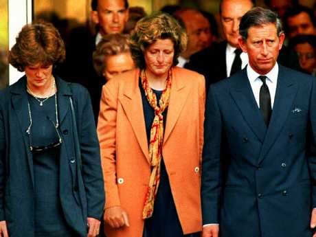 Prince Charles, along with Diana's sisters Jane and Sarah, leaving the hospital in Paris where the Princess died.