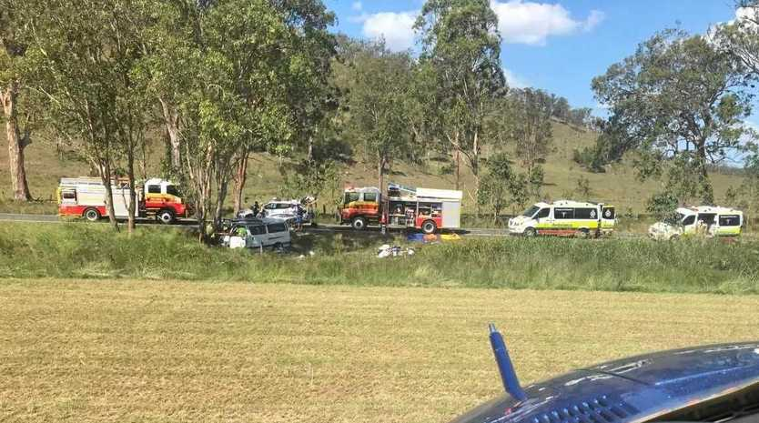 Emergency services at the crash site on the Burnett Highway on Sunday afternoon.