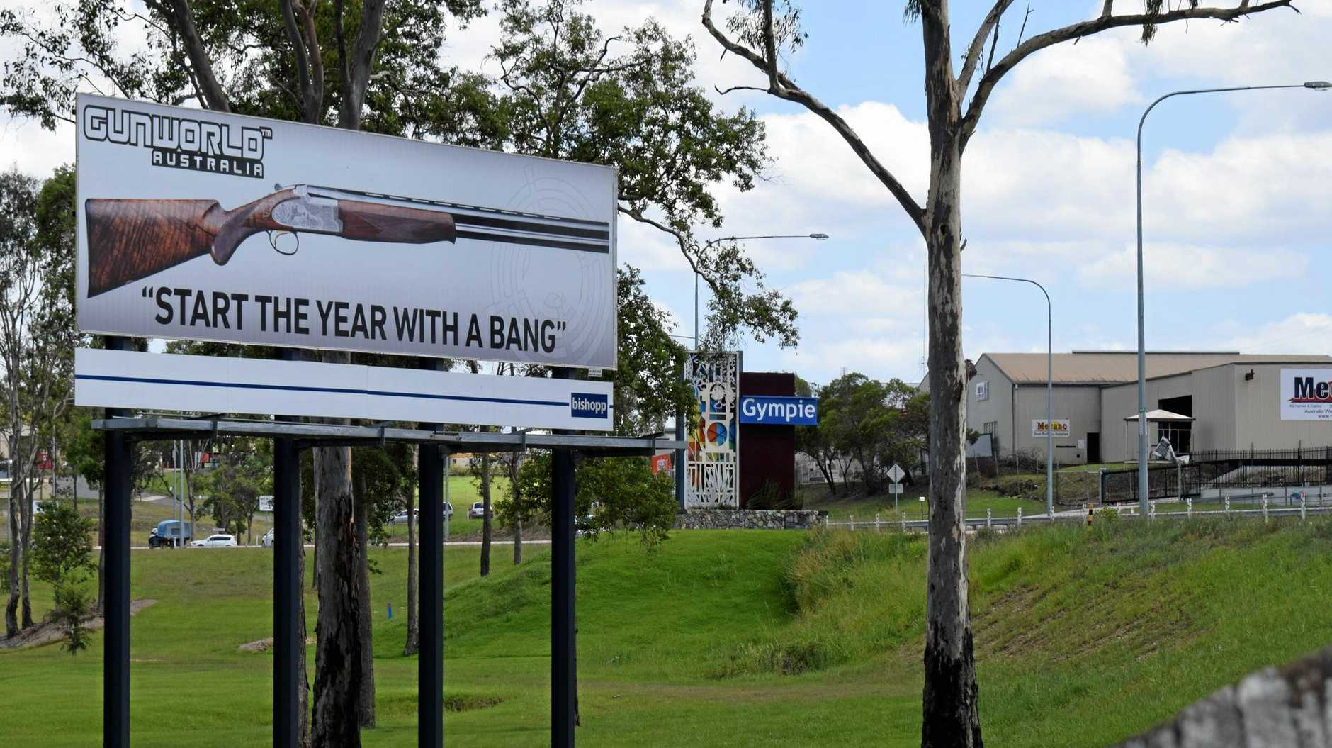 Logan- based Gun World Australia's new billboard at the northbound entrance to Gympie, the latest campaign move by a company whose ads have stirred controversy throughout the year.
