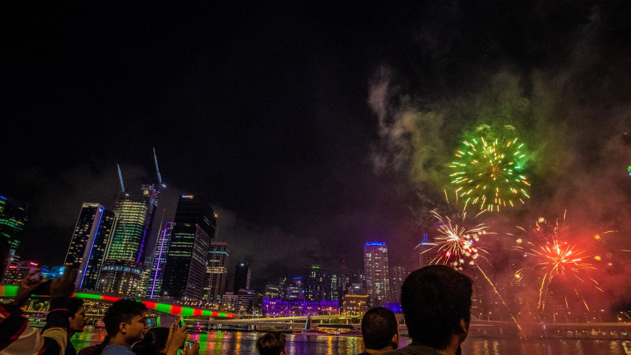 People gather to watch the skies light up. Picture: AAP Image/Glenn Hunt