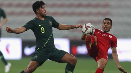 Massimo Luongo tries to stamp his authority on the game.