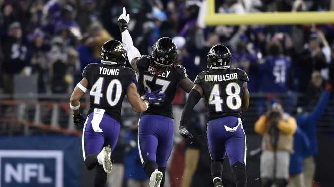 Baltimore Ravens inside linebacker C.J. Mosley, centre, celebrates his interception in the win over Cleveland Browns. Picture: AP