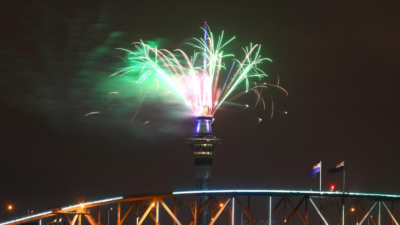 Fireworks explode from the Sky Tower with in Auckland. Picture: Phil Walter/Getty