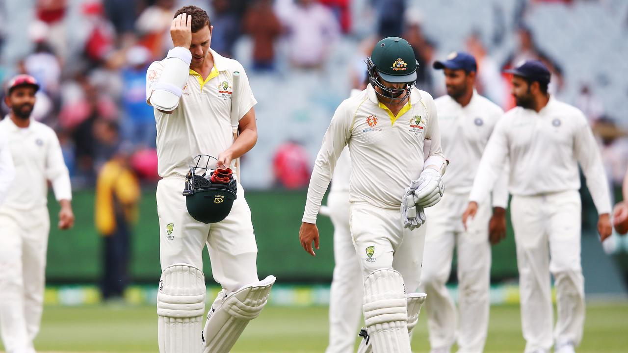 Josh Hazlewood and Nathan Lyon trudge off after a defeat to India in the Boxing Day Test completed a miserable year in Aussie cricket. (Photo by Michael Dodge/Getty Images)