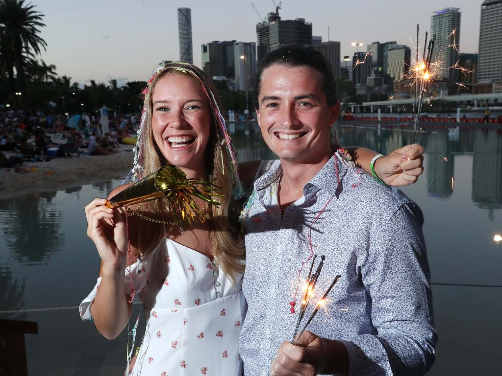 Stephanie Lamothe and Dean Cooper from Yamba, ready for NYE celebrations at South Bank. Picture: Liam Kidston