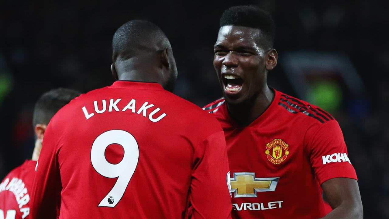 Romelu Lukaku celebrates United's big win with Paul Pogba.