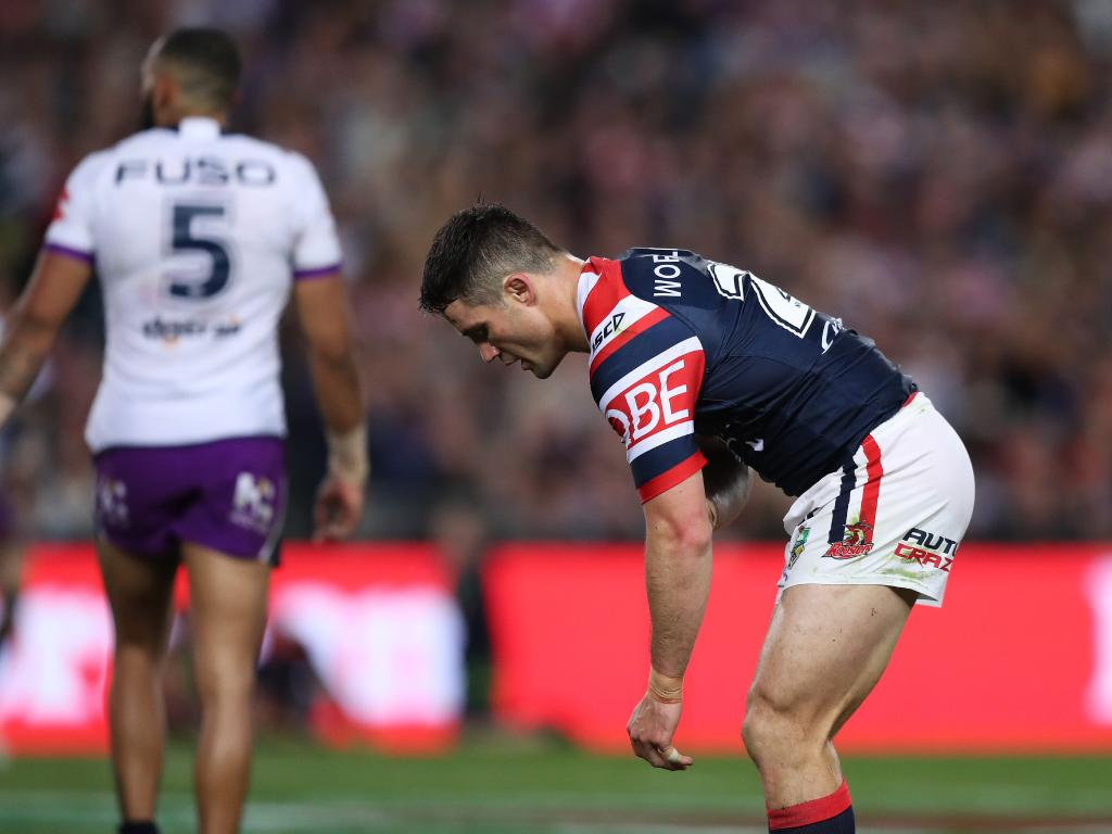 Cooper Cronk after tackling Melbourne's Nelson Asofa-Solomona during the 2018 NRL Grand Final. Picture: Brett Costello