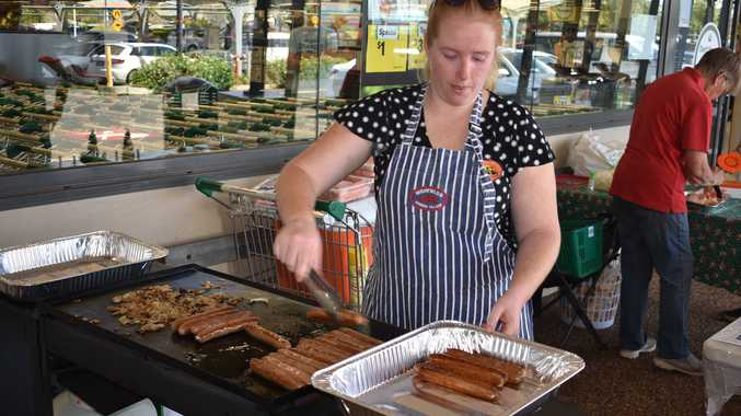 GOOD CAUSE: Stephanie Darling cooks sausages at a special fundraiser for the miniature pony Clementine who was attacked in November.