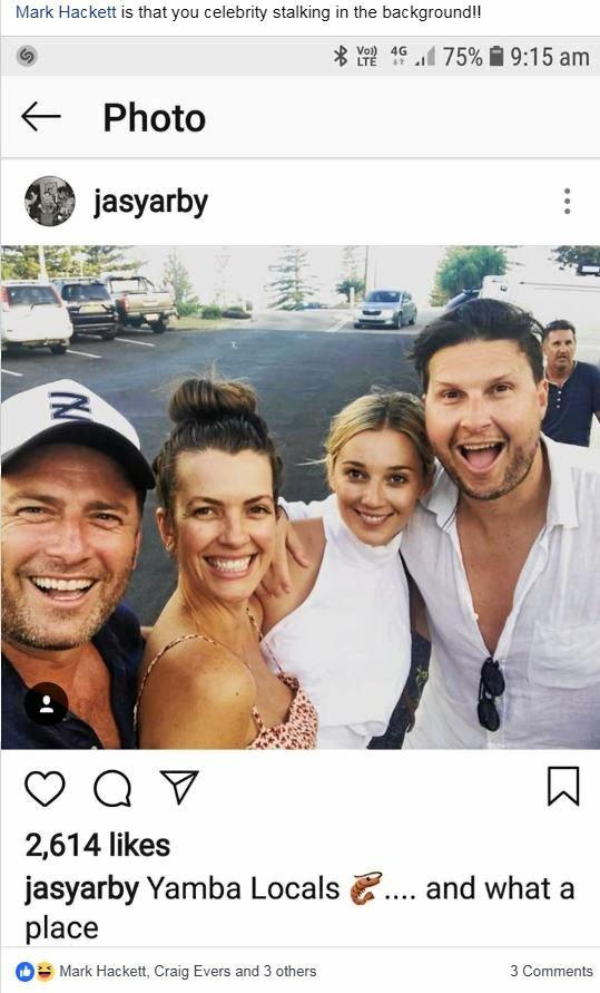 Karl Stefanovic (left) and new wife Jasmine Yarbrough (second from right) pose for a selfie with friend Lauryn Rakic and her husband while on holiday in Yamba. Unassuming Grafton businessman Mark Hackett photobombed in the background.