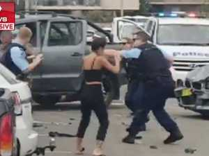 Five charged after wild beach brawl