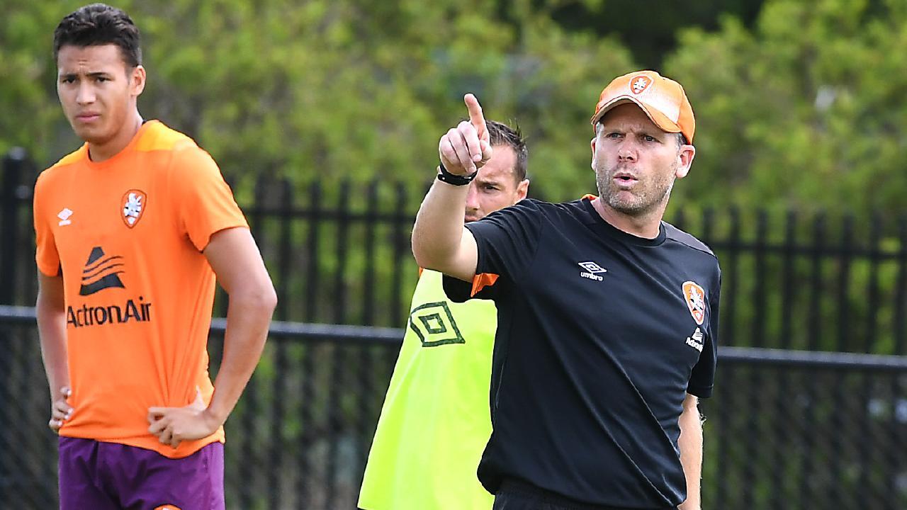Interim coach Darren Davies instructs his men. Pic: AAP