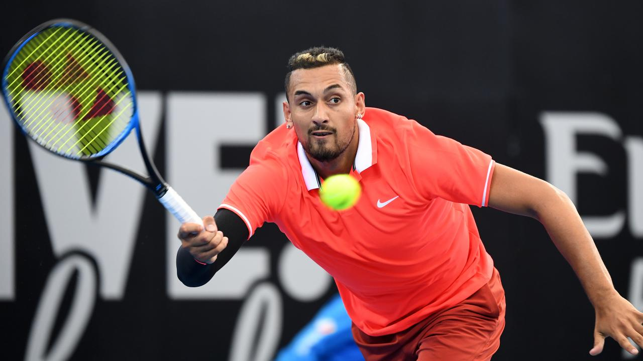 Nick Kyrgios in action during his first round match against Ryan Harrison.