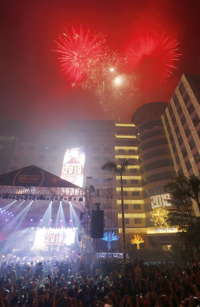 Fireworks light up the sky at the Eastwood Shopping Mall as Filipinos welcome the New Year Tuesday, Jan. 1, 2019 in suburban Quezon city northeast of Manila. Picture: AP