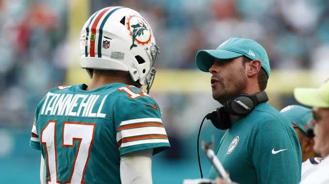 Former Miami Dolphins head coach Adam Gase talks to quarterback Ryan Tannehill. Picture: Brynn Anderson/AP