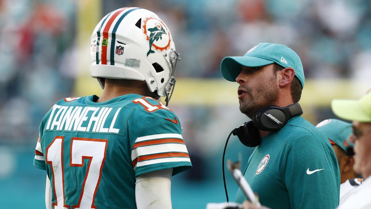 Former Miami Dolphins head coach Adam Gase talks to quarterback Ryan Tannehill. Picture: Brynn Anderson/AP