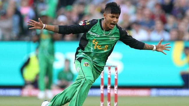 Sandeep Lamichhane celebrates the wicket of Tom Cooper in style. (AAP Image/Hamish Blair)